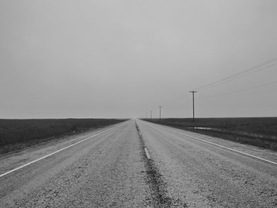 Black and white image of a lonely flat road - establishing the customer experience for business