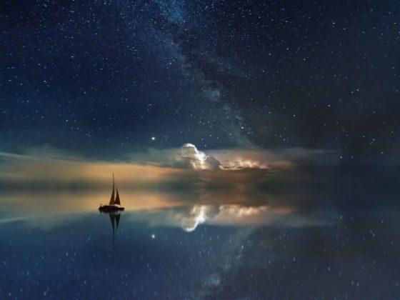 Sailboat sailing into the dark clouds at night - More Human Navigation